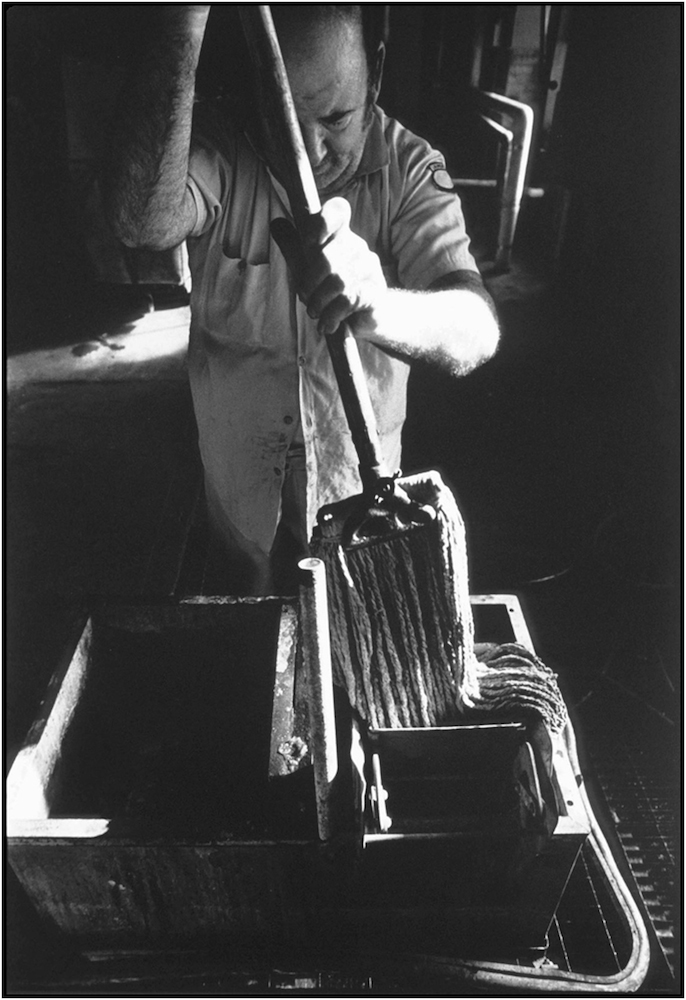 Housekeeping aide at Bellevue Hospital laundry. 1985.
