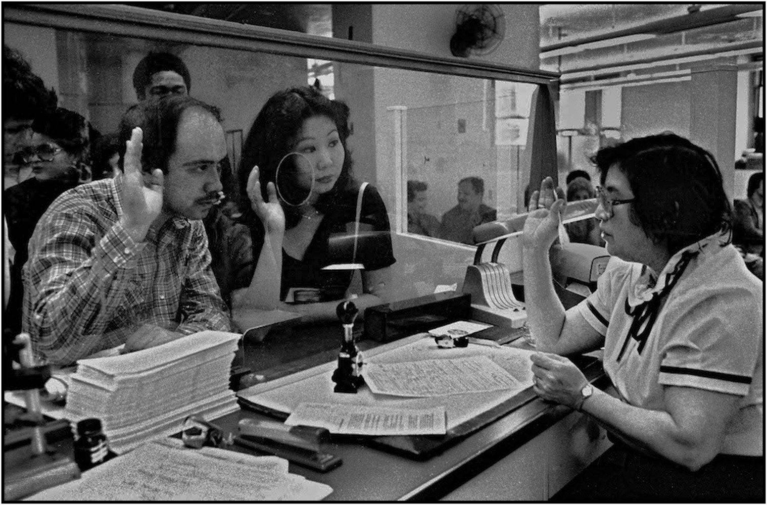 Union member accepts sworn statement from a couple at Marriage License Bureau in Municipal Building, Manhattan. 1981.
