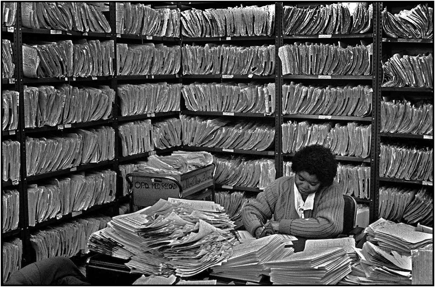 Sandra Winslow works with emergency medical charts at Kings County Hospital, Brooklyn.1988.