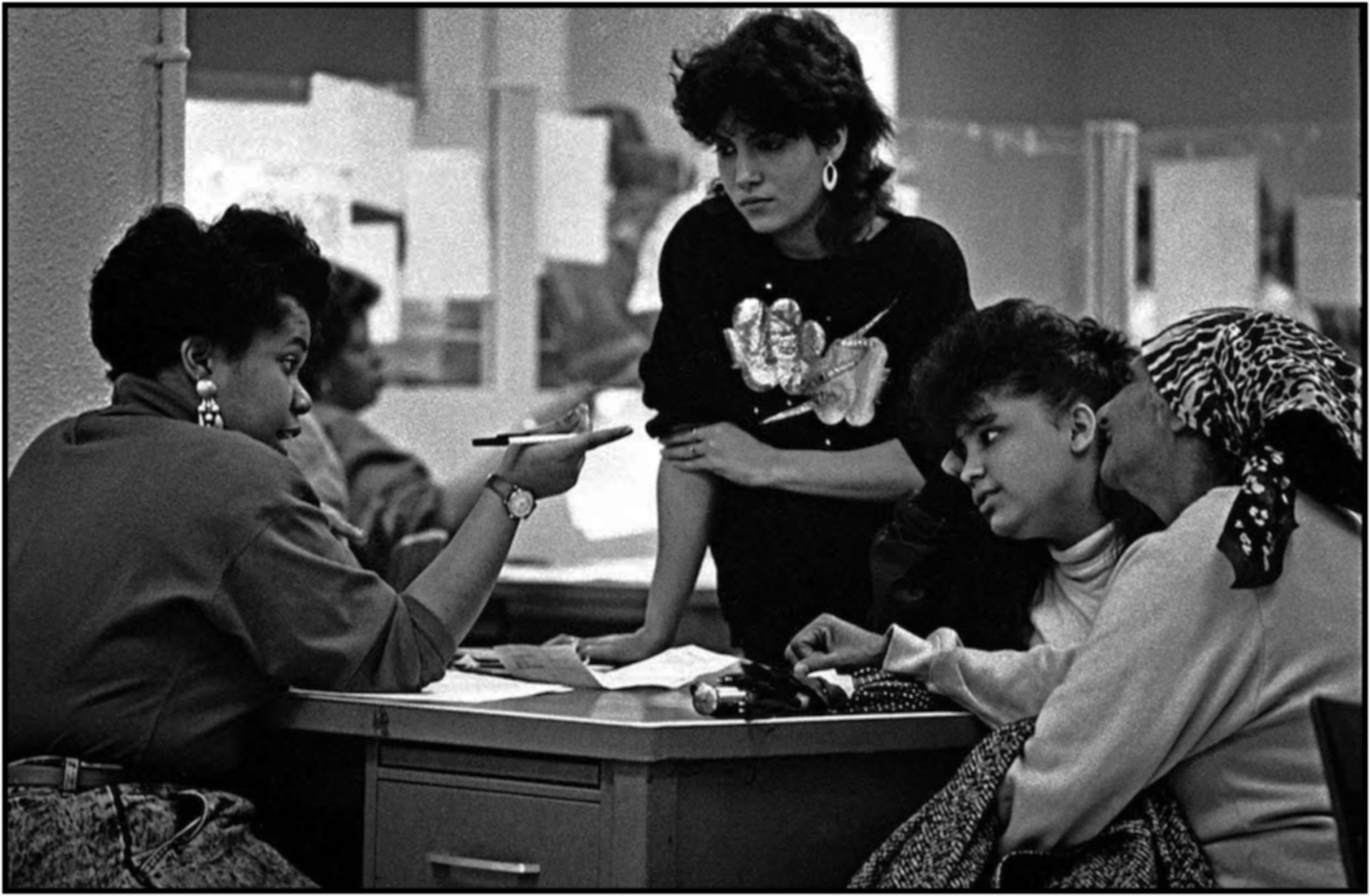 Eligibility specialist Kenyatta Jones (left) works with family at a Queens income maintenance center. 1988.