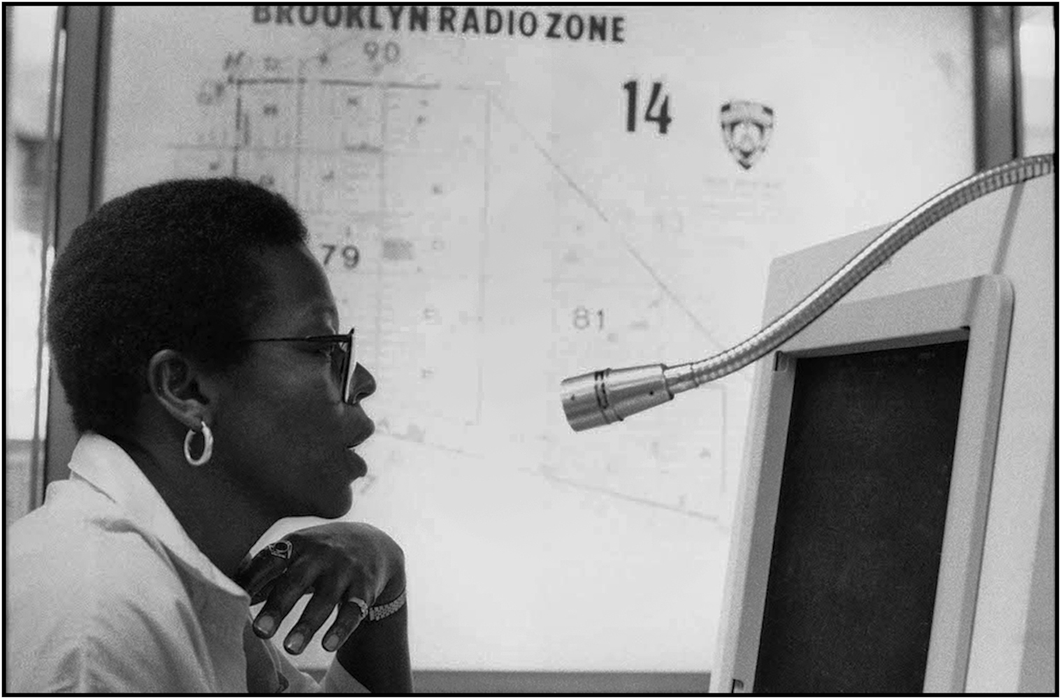 911 operator Cheryl Watts, a Police Communications Technician, at One Police Plaza, Manhattan. 1988.