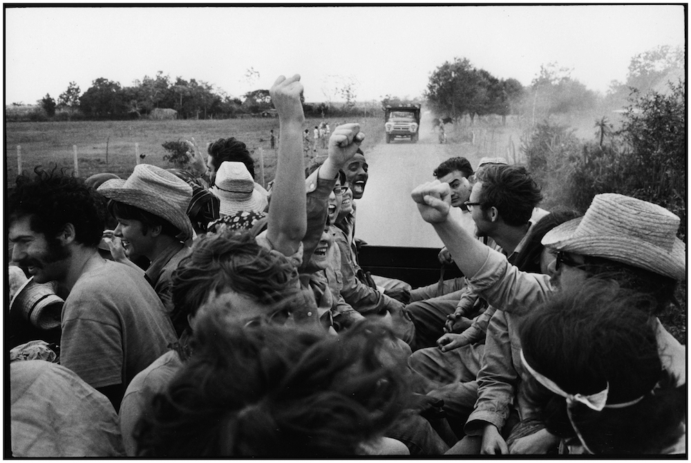 FIRST VENCEREMOS BRIGADISTAS TRUCKED TO CANE FIELDS  1969  George Cohen    copy.jpg