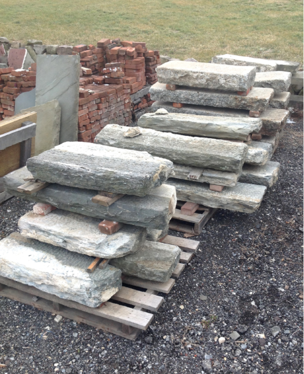 Copy of Salvaged stone building lintels waiting to become the next thing.