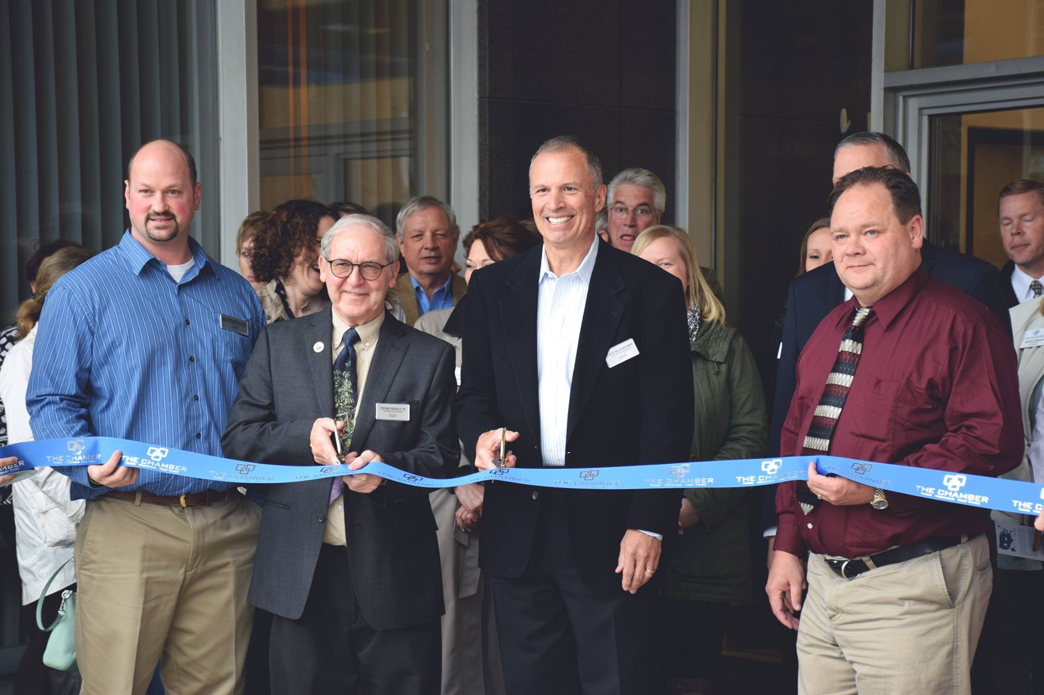 Ribbon cutting ceremony with the Fargo - Moorhead Chamber of Commerce celebrating the acquisition.  (Shown L to R LJA VP Nate Anderson, LJA President Stevan Dewald, WAI President David Wolterstorff, LJA VP Troy Tooz)