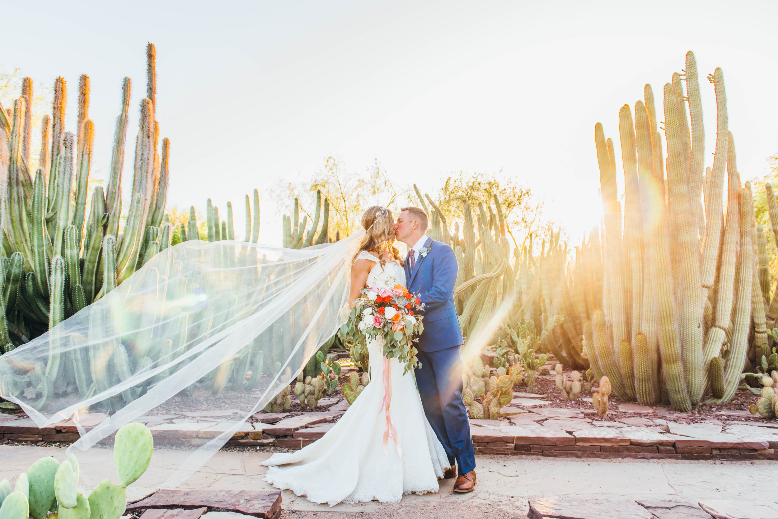 desert wedding veil blowing in wind cactus garden wedding bride groom in cactus windy desert wedding Grey Key Events photos by Shots By Angie.jpg