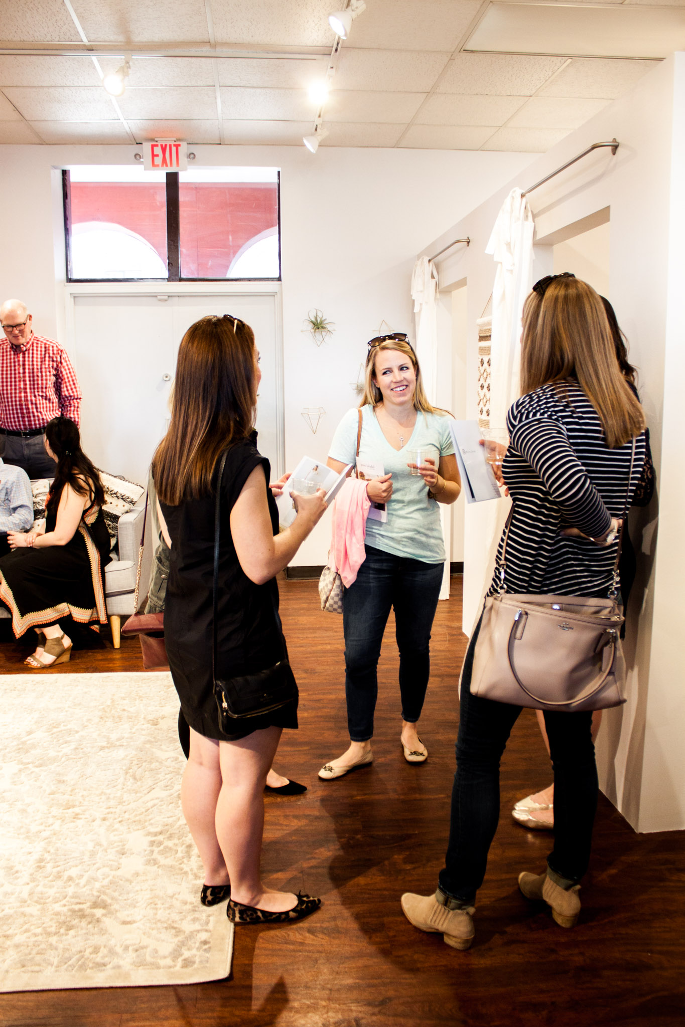 Open house attendees mingle around Juno's fitting rooms. Photo by Cassandra Lu