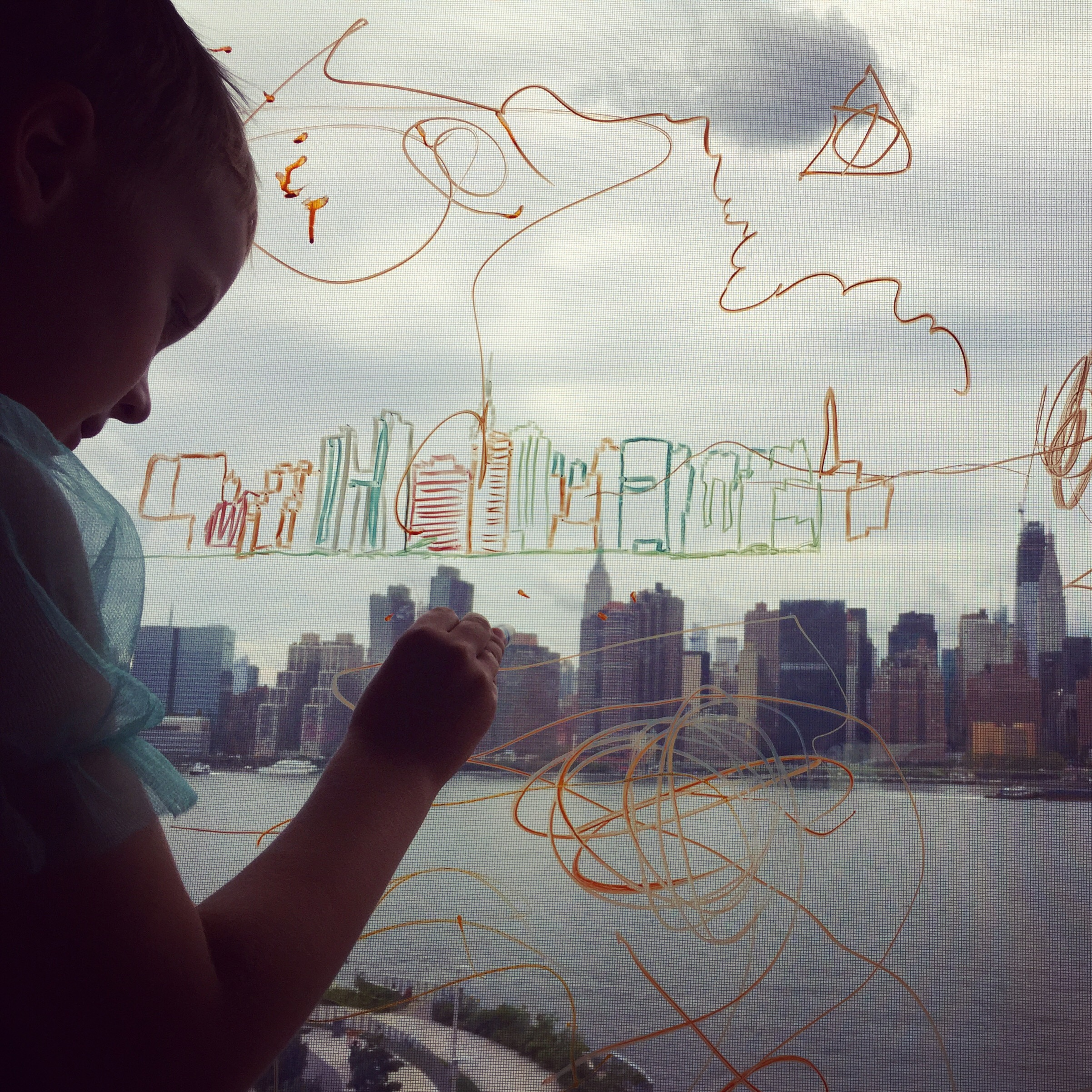 Nephew Davey improving Robert's sketch of New York City