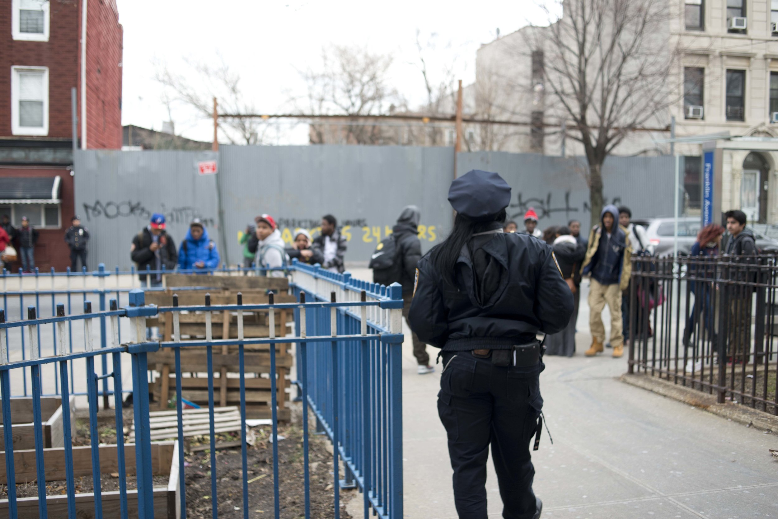 A police officer stands watch after school is dismissed.