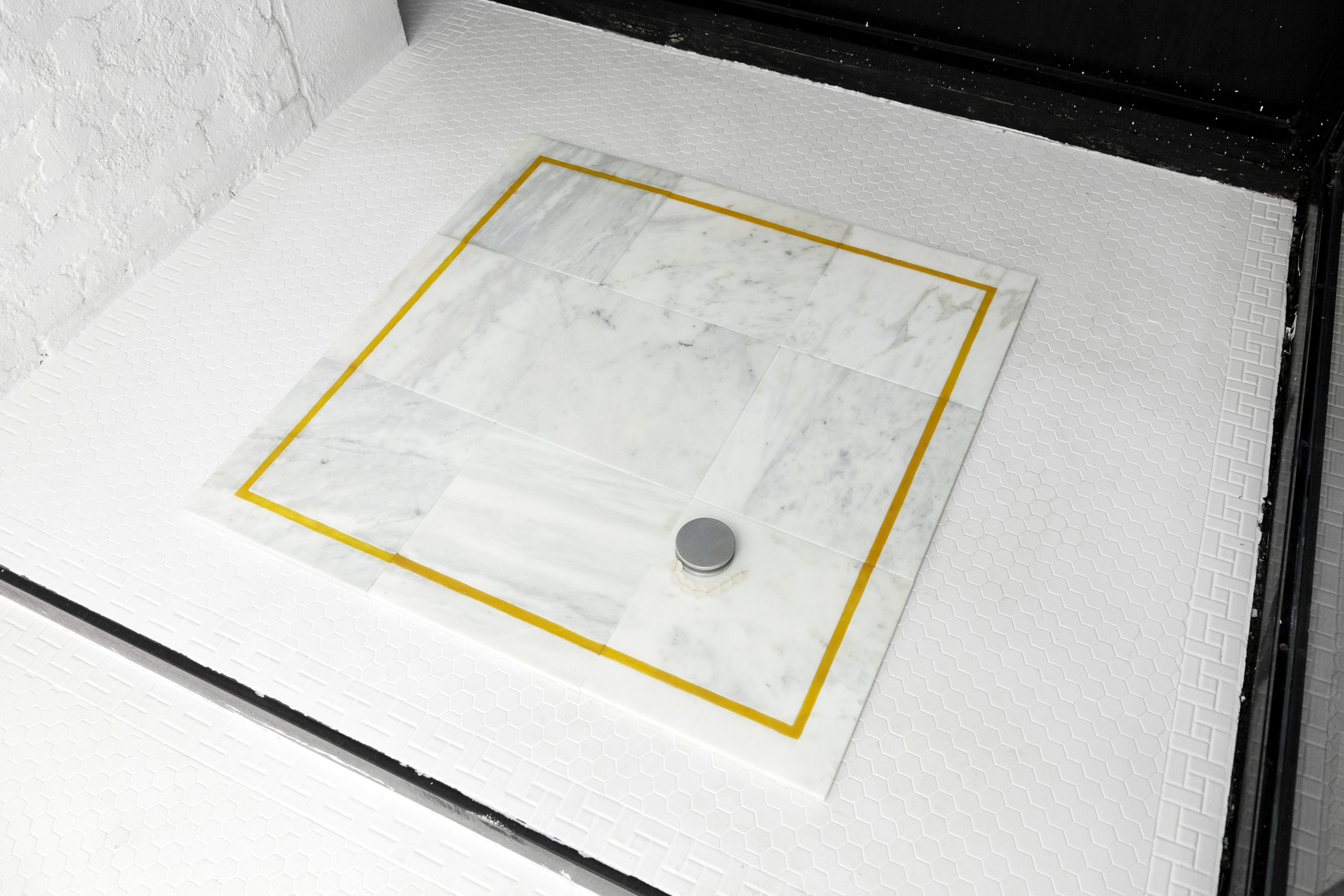 """""""Marble on Marble""""performance  20mm duration. Carrara marble tiles, rubber, aluminum tools, glass beads 2018"""