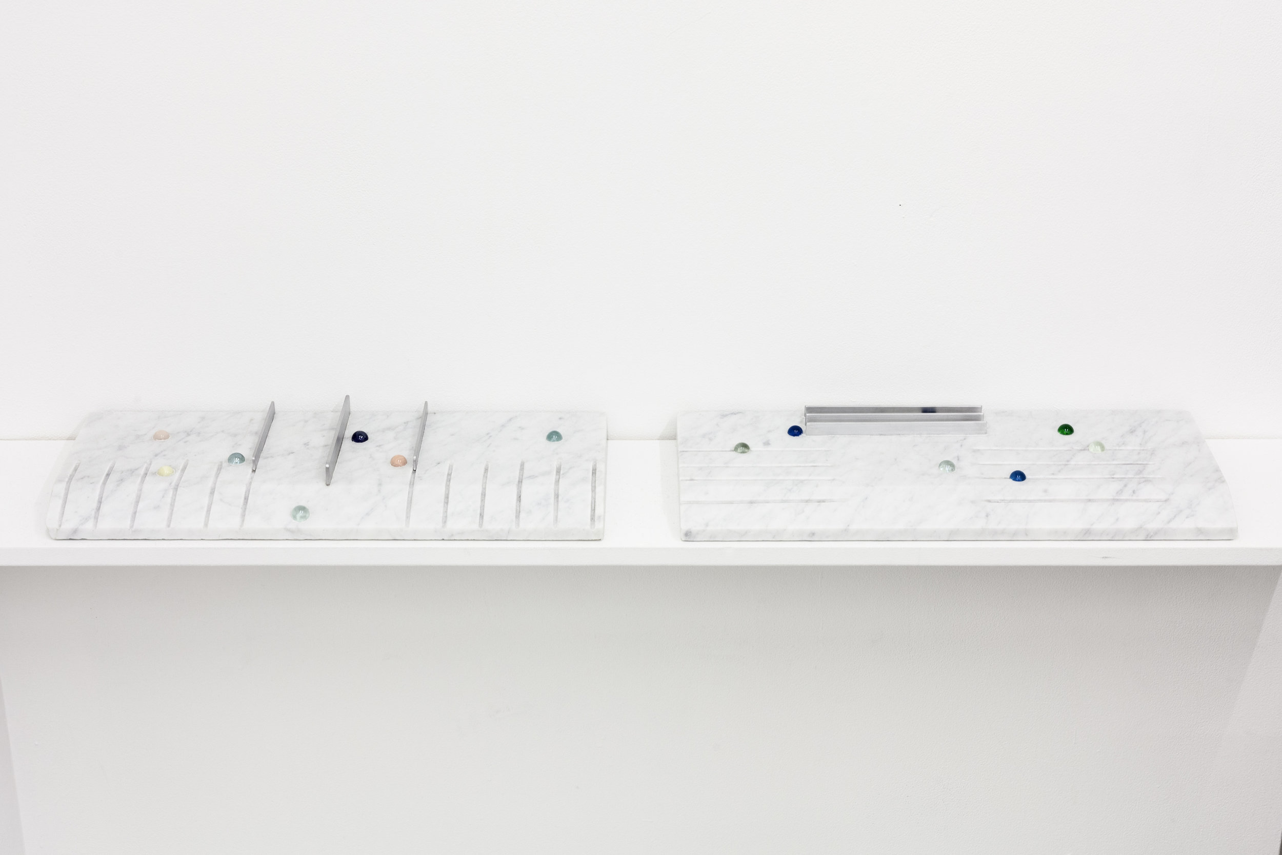 """Short Cut Keys Tablet"" (1, 2)  18"" x 7"" x 2"" Carrara marble slab, glass marbles, aluminum 2018"