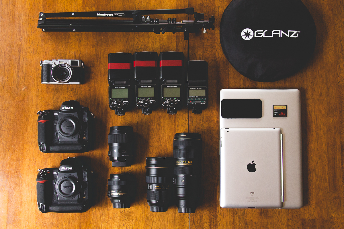 This is the work kit. As you can see, the core set from the previous post is all there. I'd never use all this at once, and mostly it rolls around in  one of these that stays in the car. I use the 35 and 85 mostly, and the 24-70 is rarely used at anything other than 24mm!I use the 70-200 sparingly but it's lovely for headshots as the compression at 200mm is great. The 24-70 will be replaced in this kit by the 24/1.4G really soon. The reflector and light stand are great tools, and I use a bunch of softboxes and umbrellas when required.