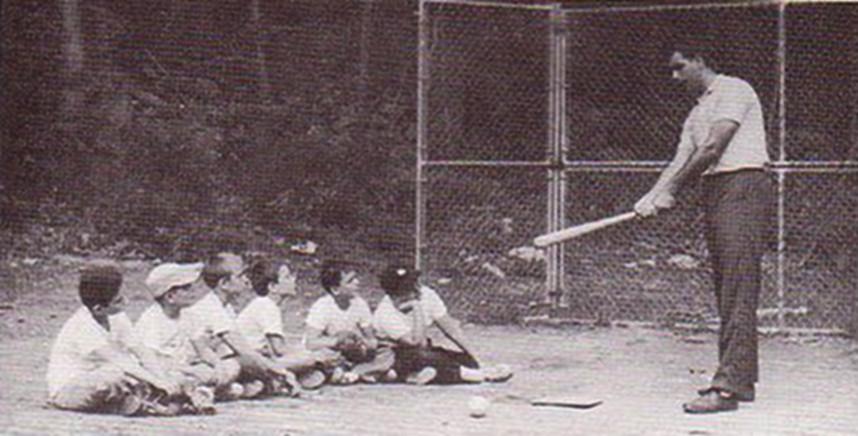 Ron instructing baseball