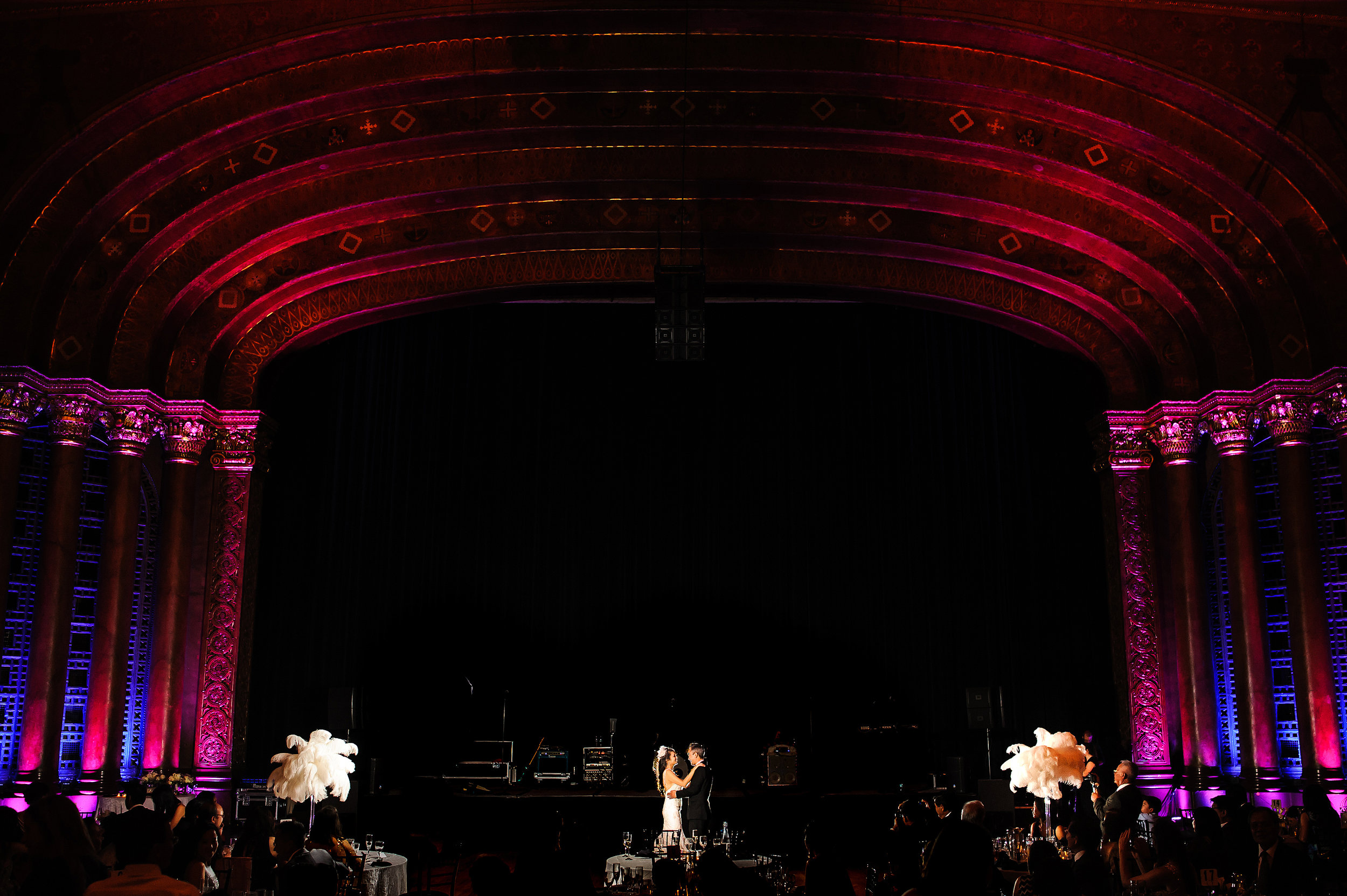 Epic uplighting during bride and grooms first dance during wedding at the Memorial Auditorium in Sacramento California.