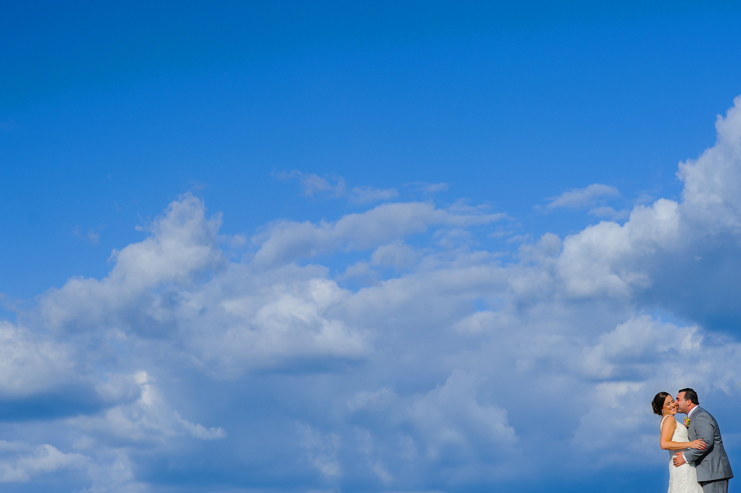 Blue sky and clouds wedding portrait at Helwig Winery in Plymouth California.