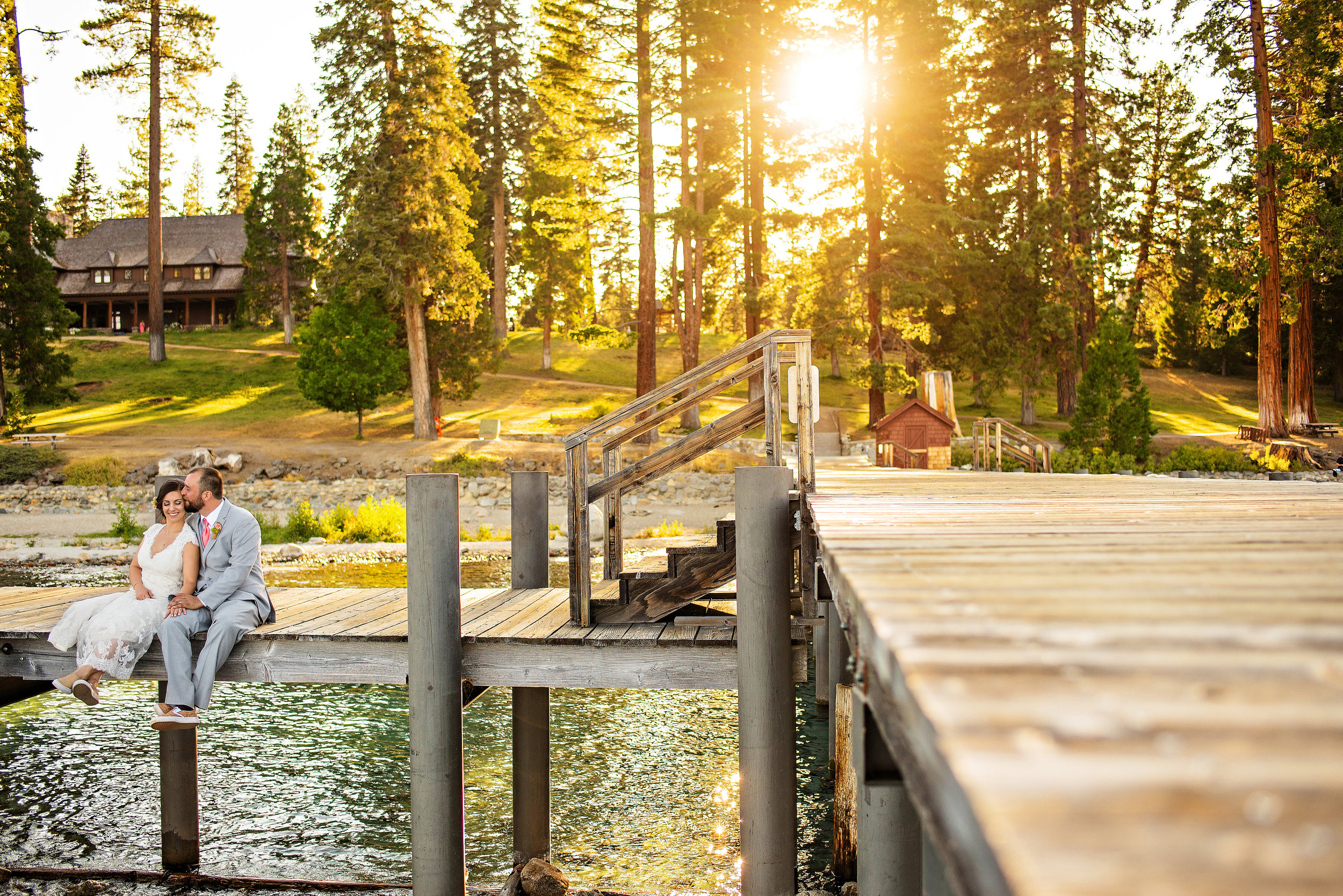 Bride and groom portrait on a dock during wedding at Hellman-Ehrman Mansion in Tahoe California.