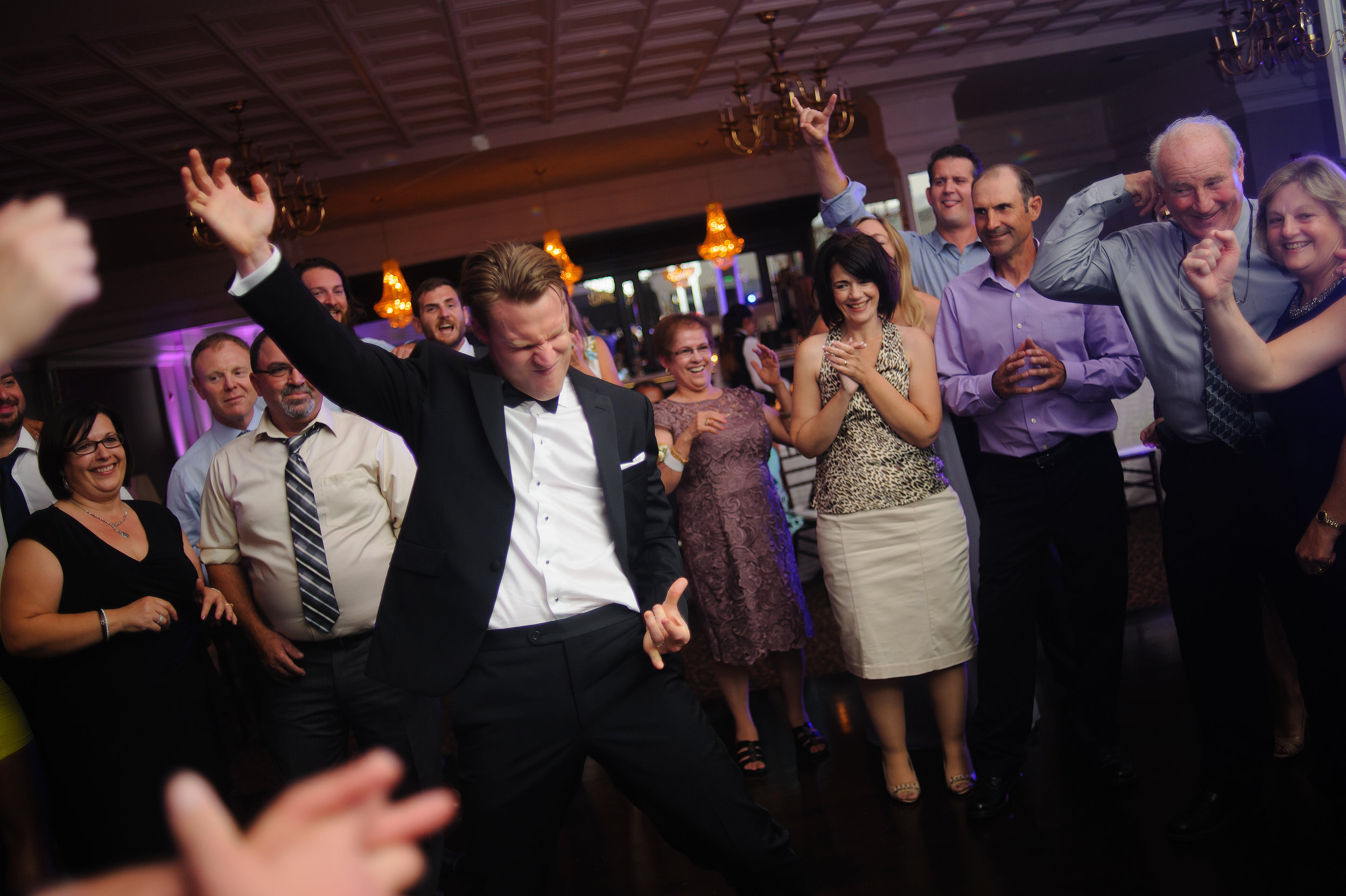 Groom dancing at reception during wedding at Arden Hills Club and Spa in Sacramento California.