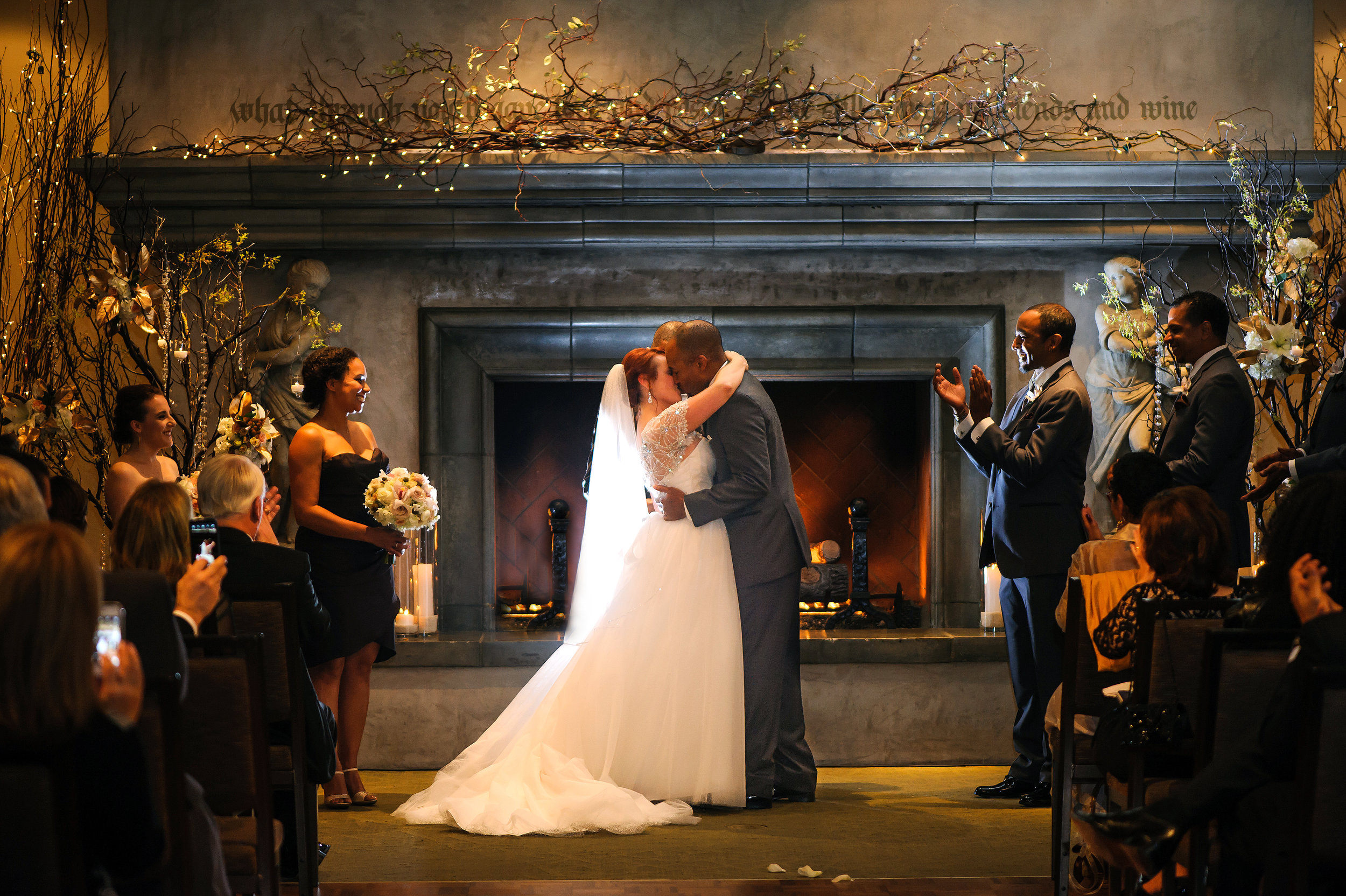 First kiss during wedding ceremony at Wine and Roses in Lodi California.