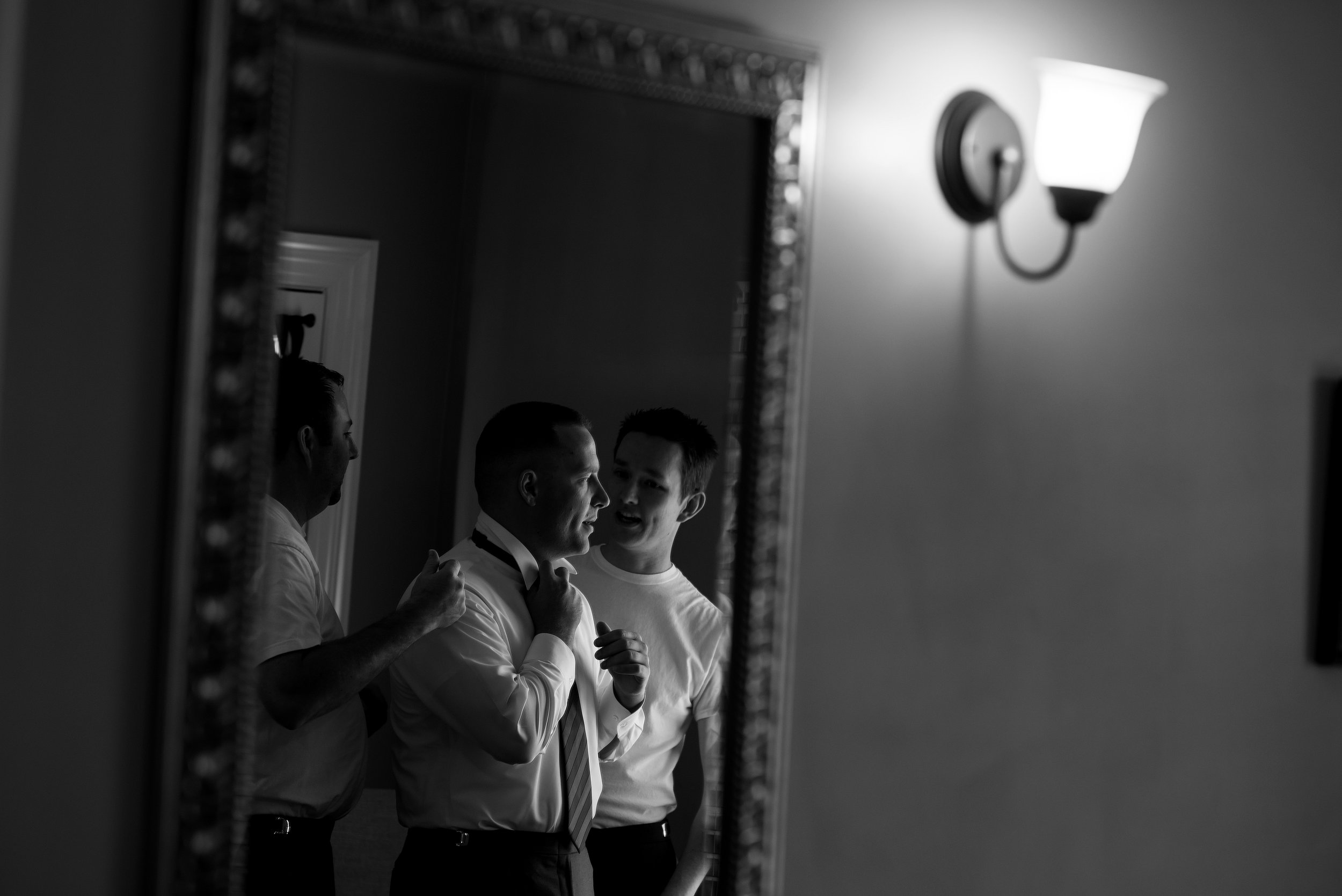 Groom getting ready for wedding at the Monte Verde Inn in Foresthill California.