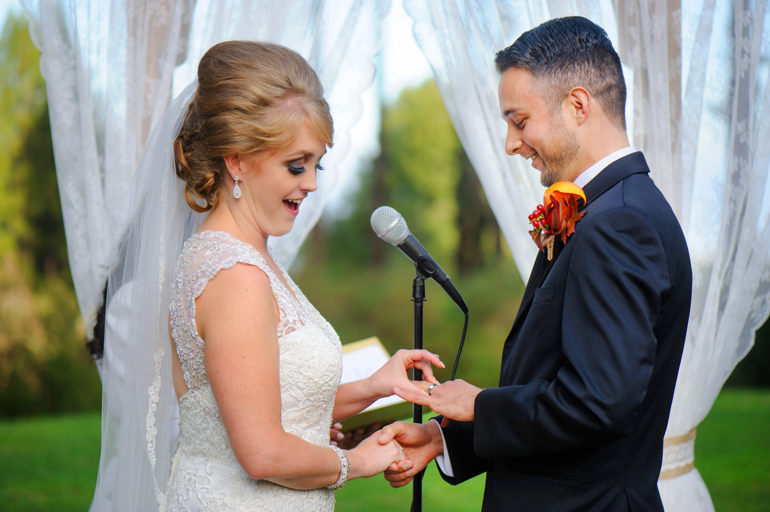 Ring exchange during wedding ceremony at The Mountain Terrace in Woodside California.