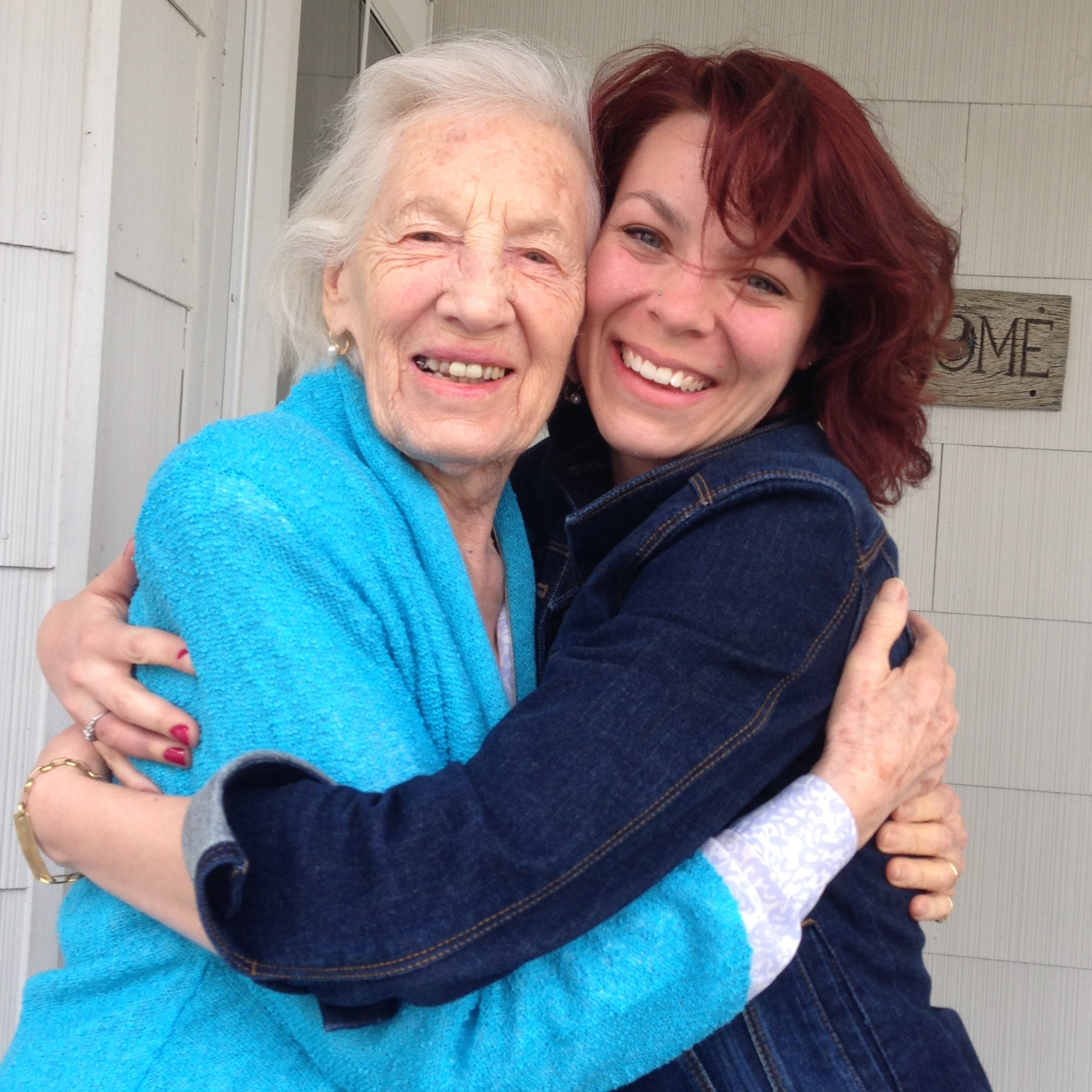 Here I am with my grandmother, whose handwriting is the font for the logo itself.