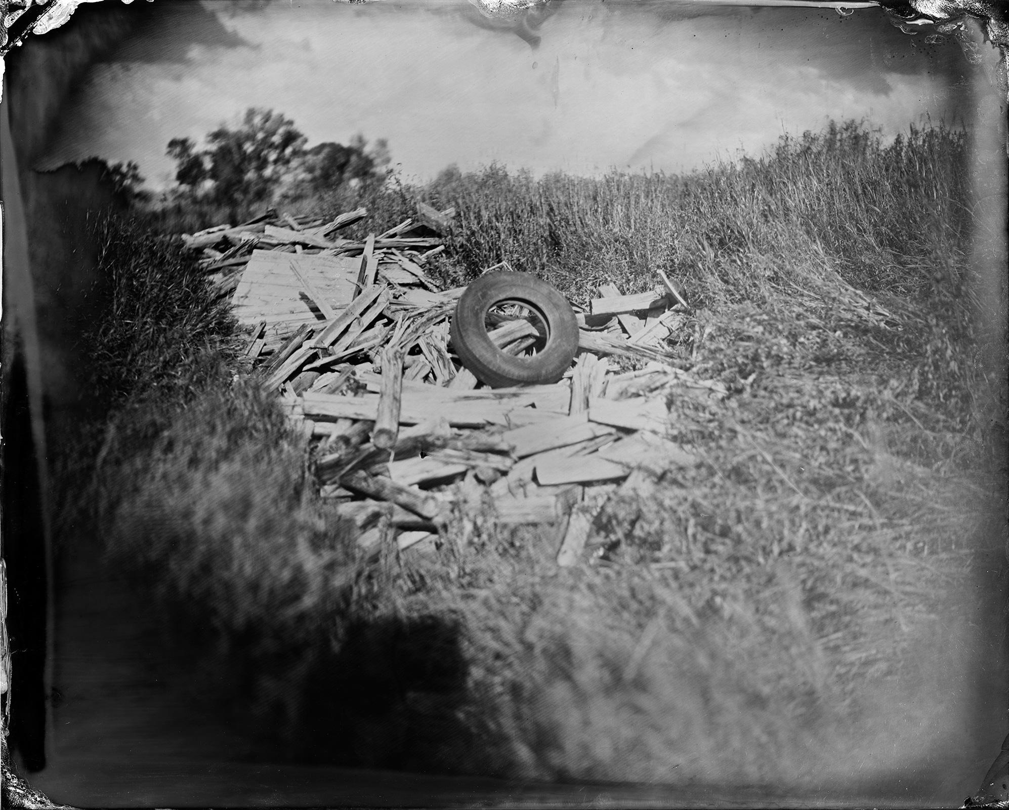 Tire & Wood Pile