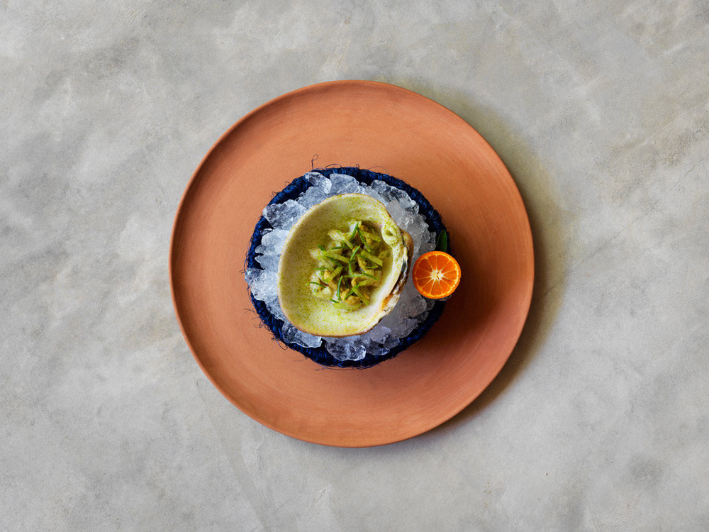 Melon-Clam-from-the-sea-of-Cortez-served-with-Beach-Herbs-and-Mandarin.jpg