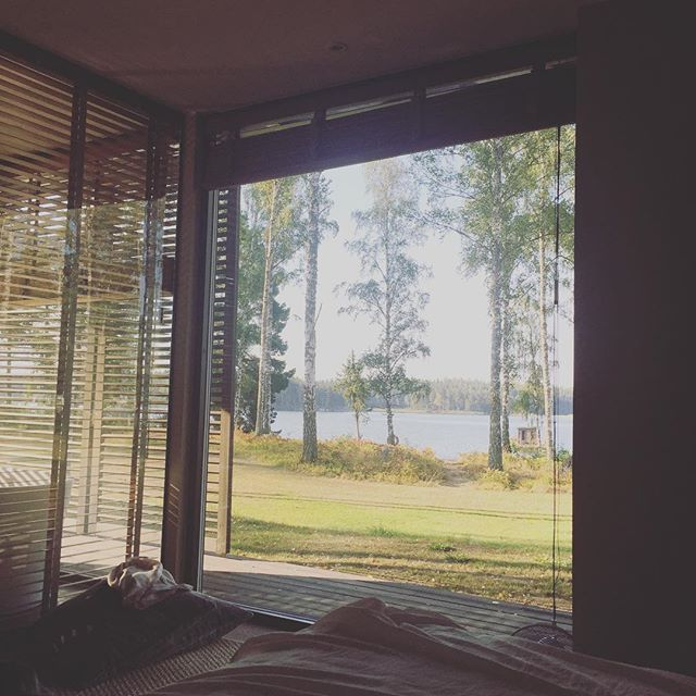 Drawing in bed with my biggest boy this morning and this view. This is a little slice of heaven on Earth. I feel so incredibly chilled and happy right now, I may not come home. #essentialselfcare #happy #ilovesweden #holidays #lakeview #roomwithaview