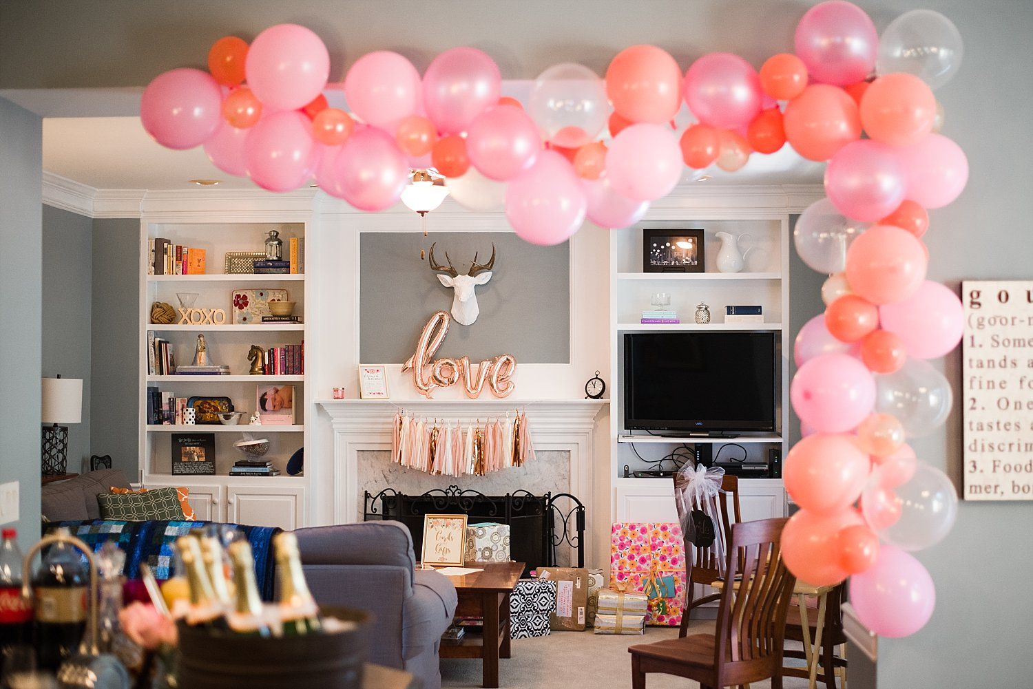 pink balloon arch and bridal shower decor