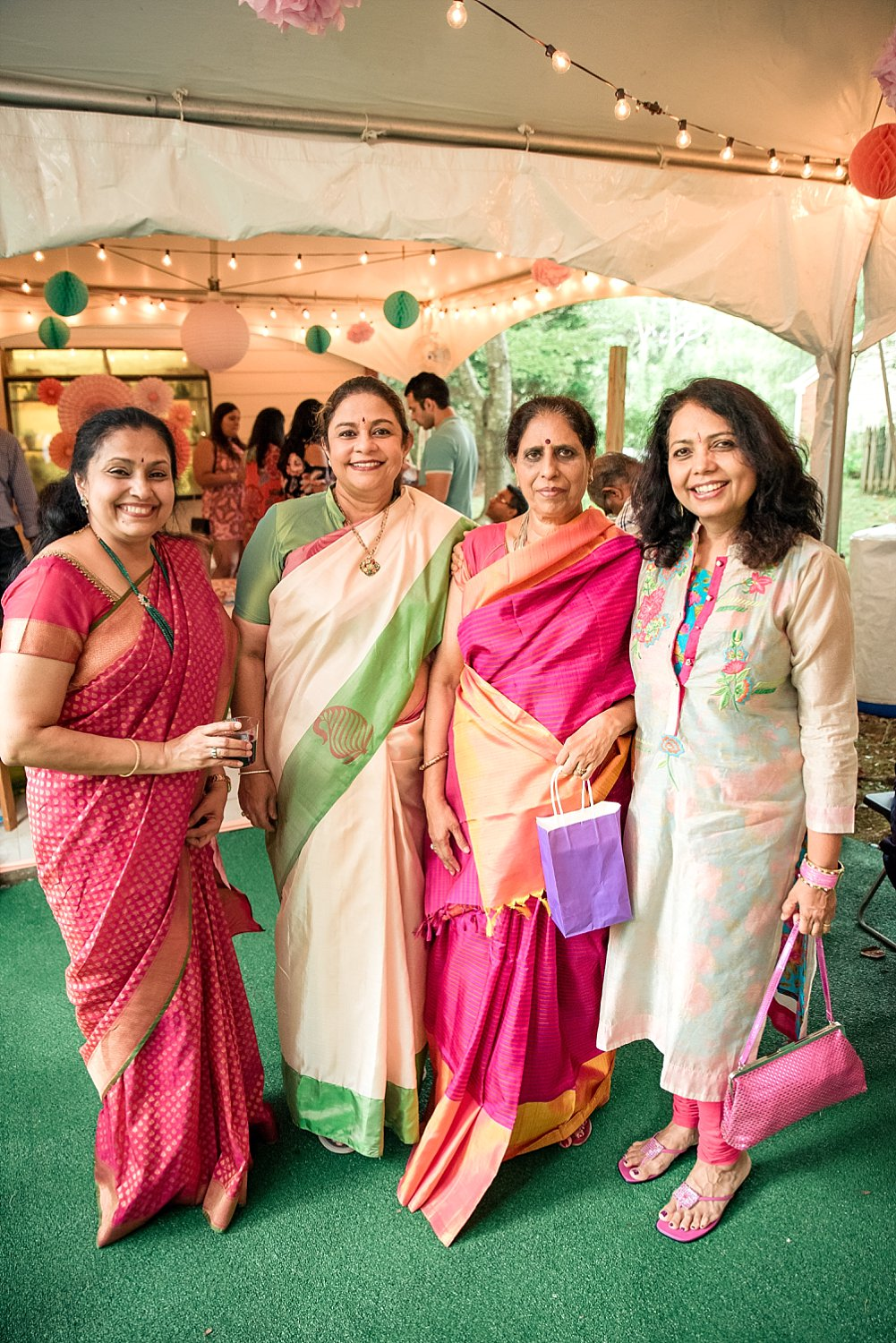 4 women in Saris at baby shower in Roswell, GA