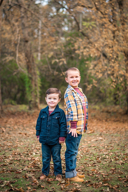 Brothers in fall leaves in Atlanta
