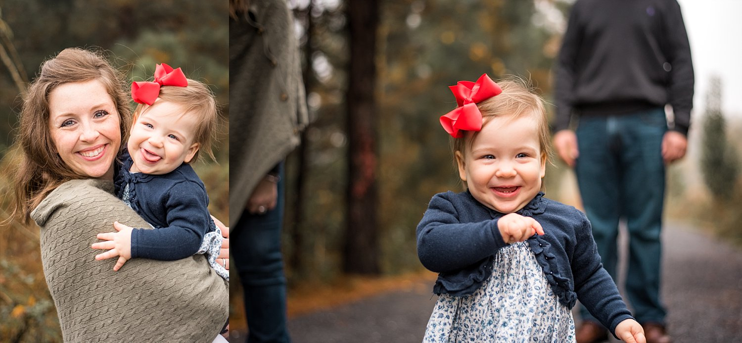 mother and toddler daughter with red bow laughing