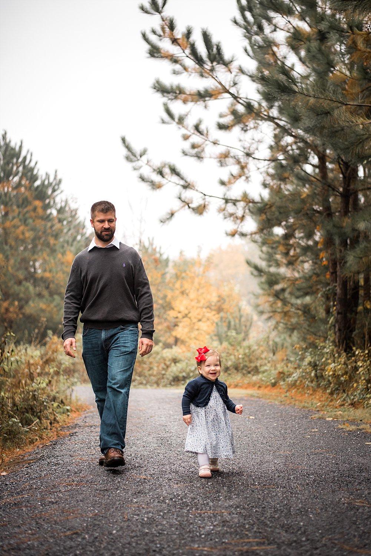 daddy and daughter walking down path at Garrard Landing Park