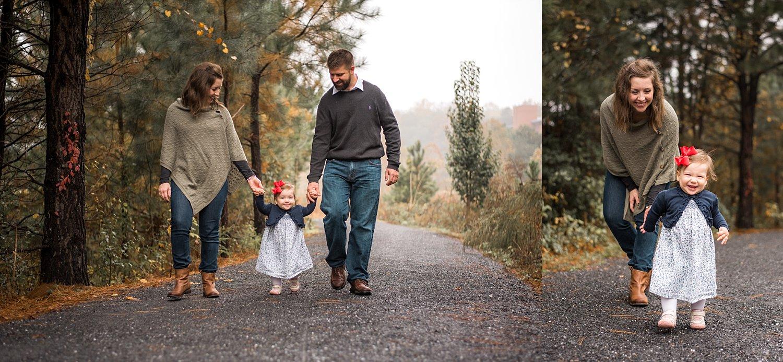Family of 3 walking on path at Garrard Landing Park in Roswell, GA