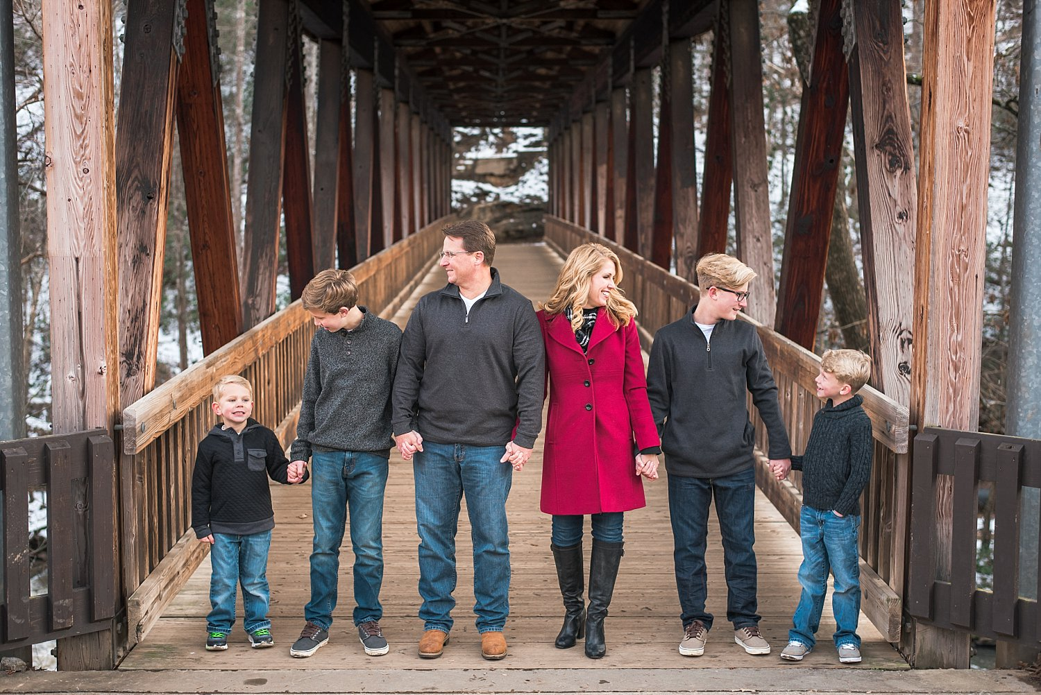 Family of 6 on covered bridge at Roswell Mill