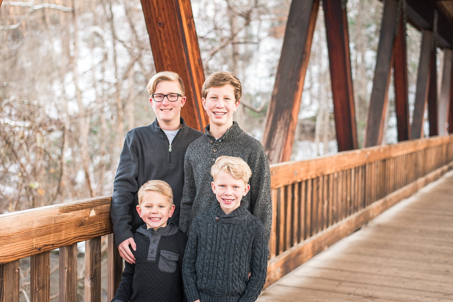 4 brothers on covered bridge in Roswell, GA