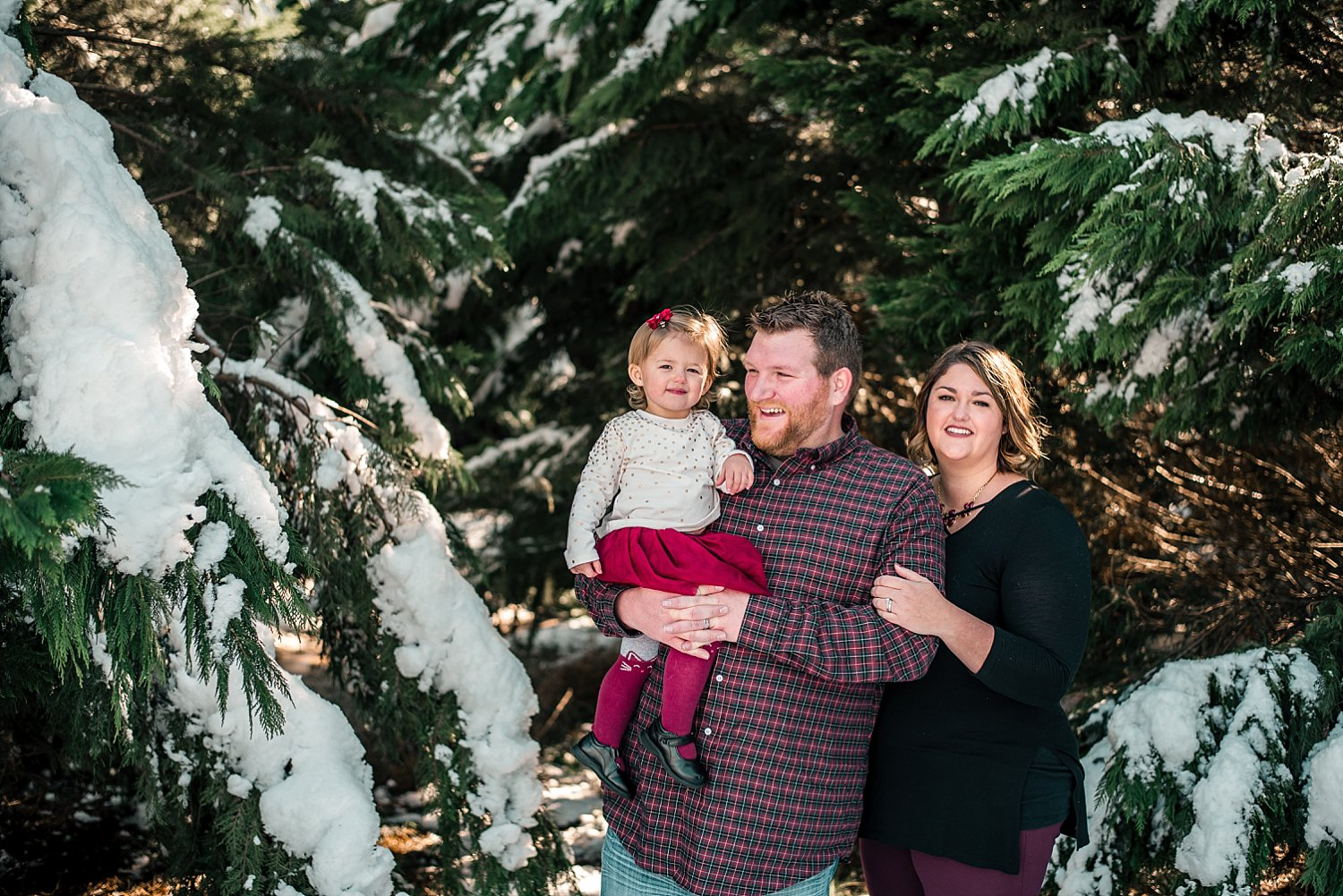Family of 3 in snow at Barry Patch Farms, Woodstock