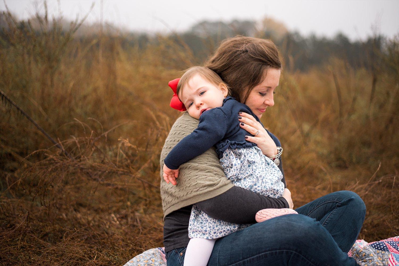 Mom hugging toddler girl in Roswell, GA