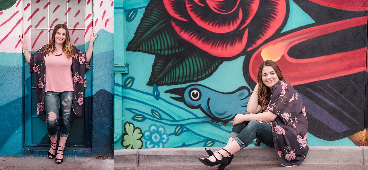 Senior girl in front of painted mural in city
