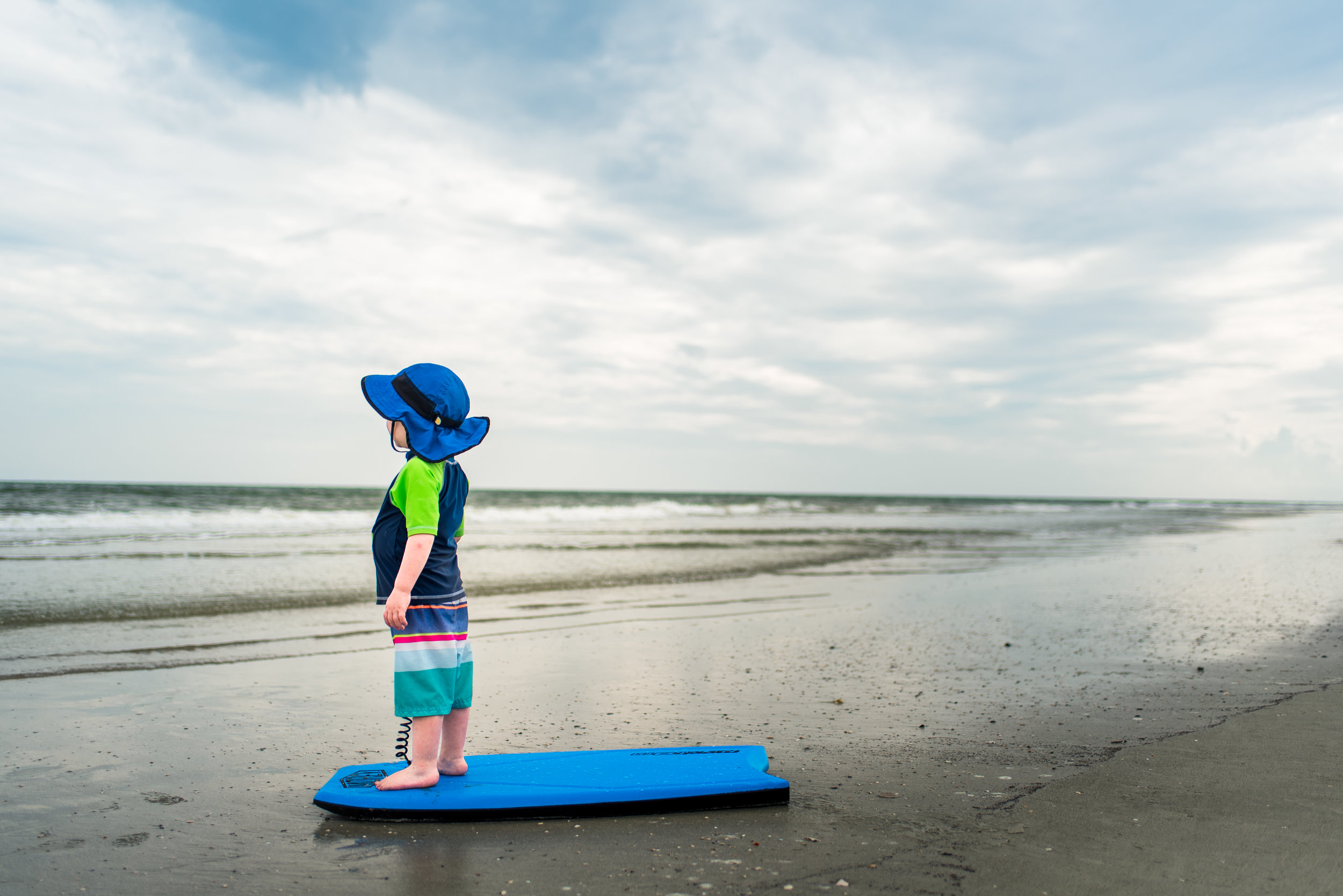 toddler looking out at ocean on Hilton Head Island Beach | Summer Bucket List | adriennelouisephotography.com