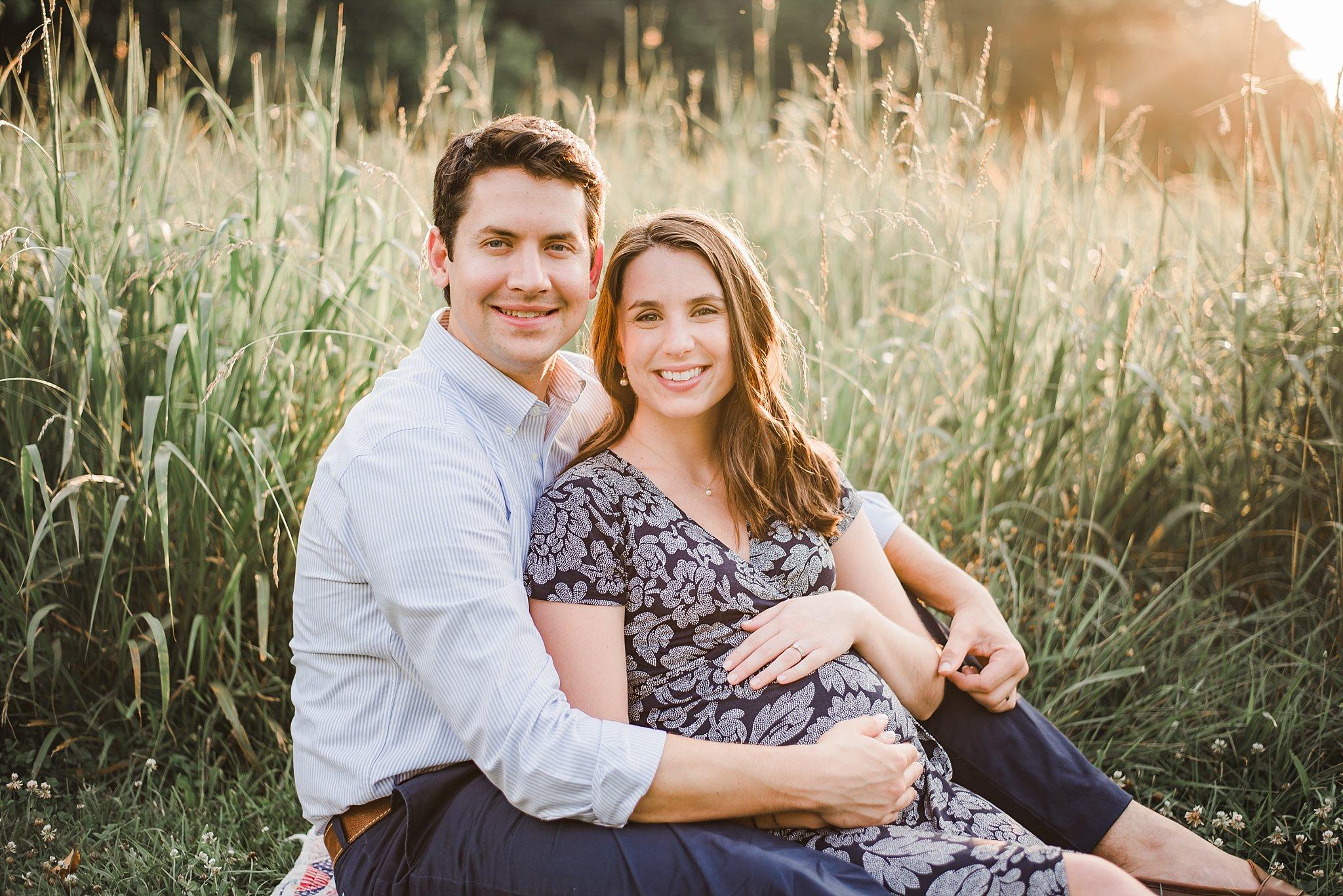 Expecting Couple in field of tall grass Marietta, GA