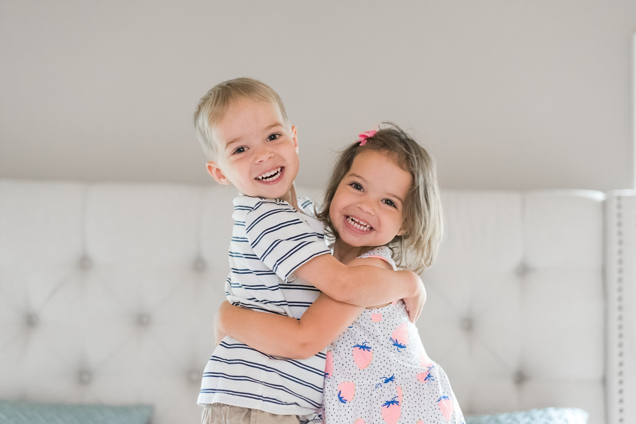 portrait of boy/girl twins hugging
