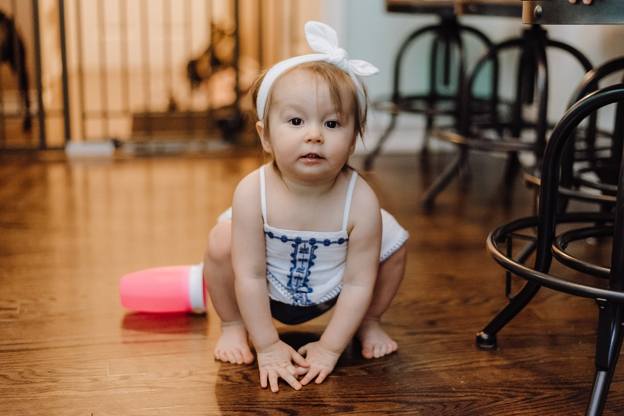 toddler girl squatting