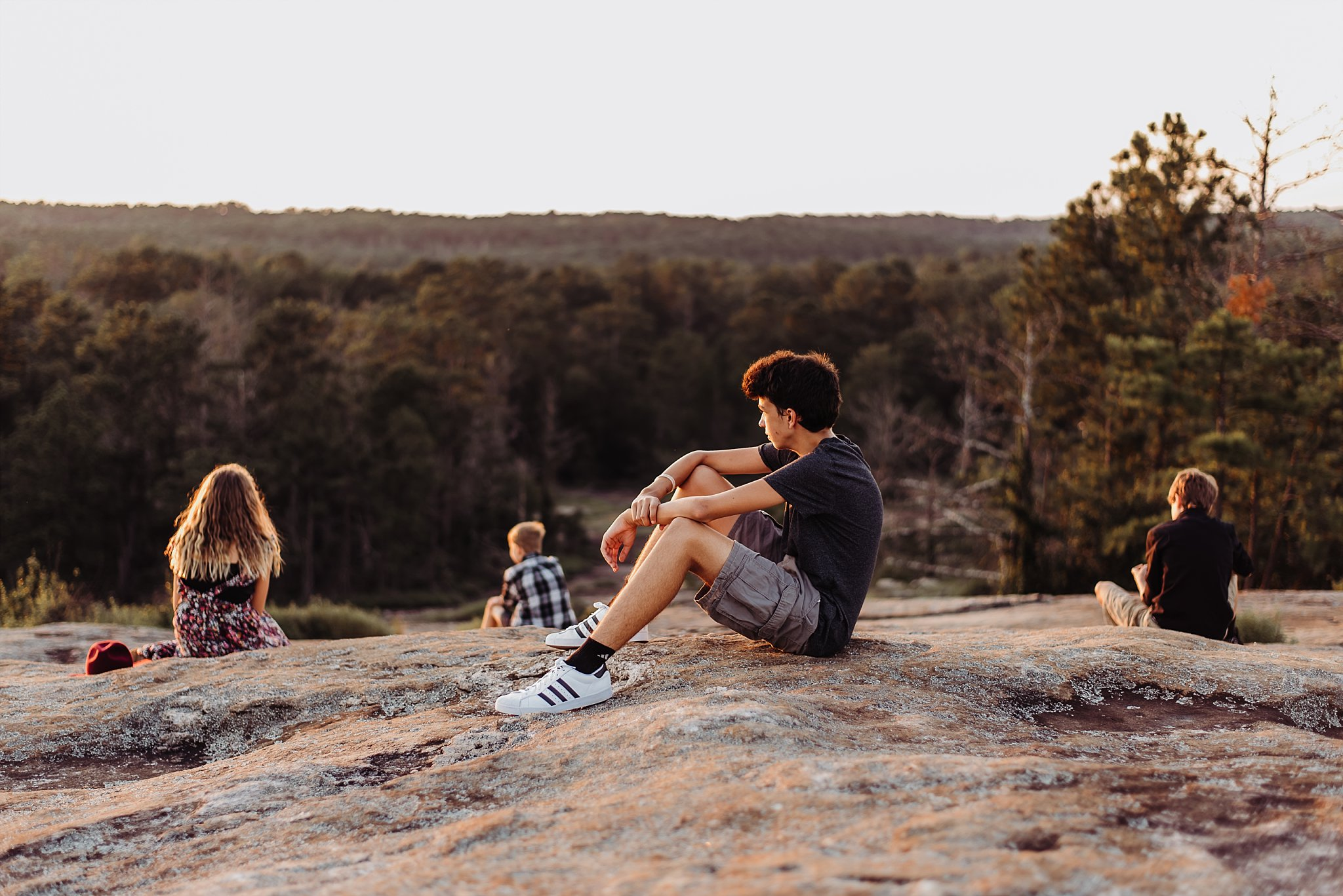 4 kids looking out at Arabia Mountain sunset