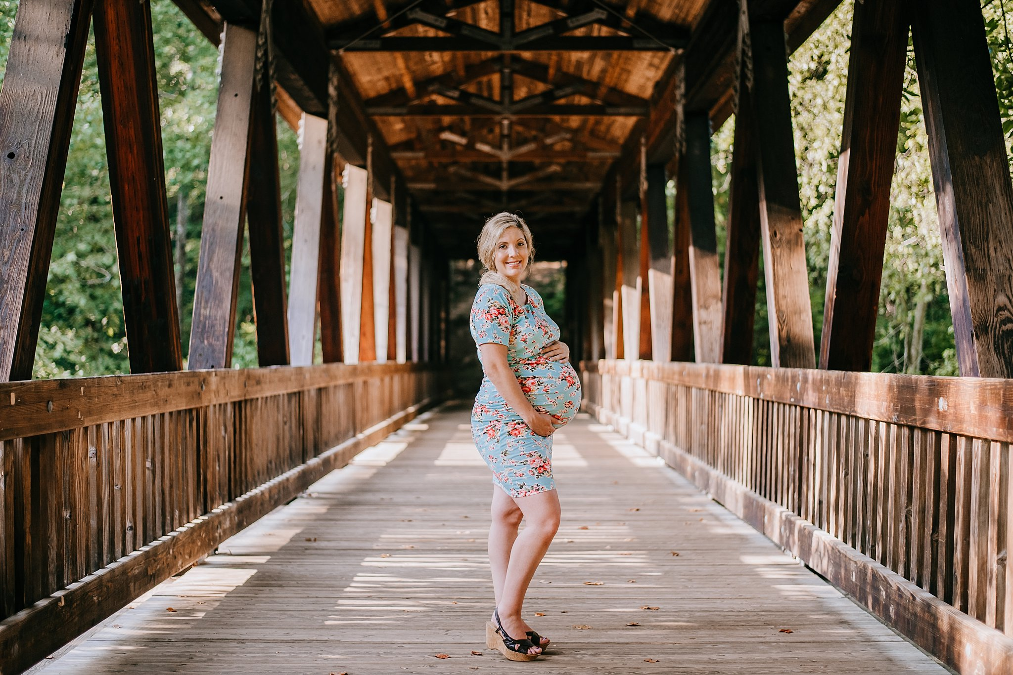 Pregnant mom on covered bridge at Roswell mill