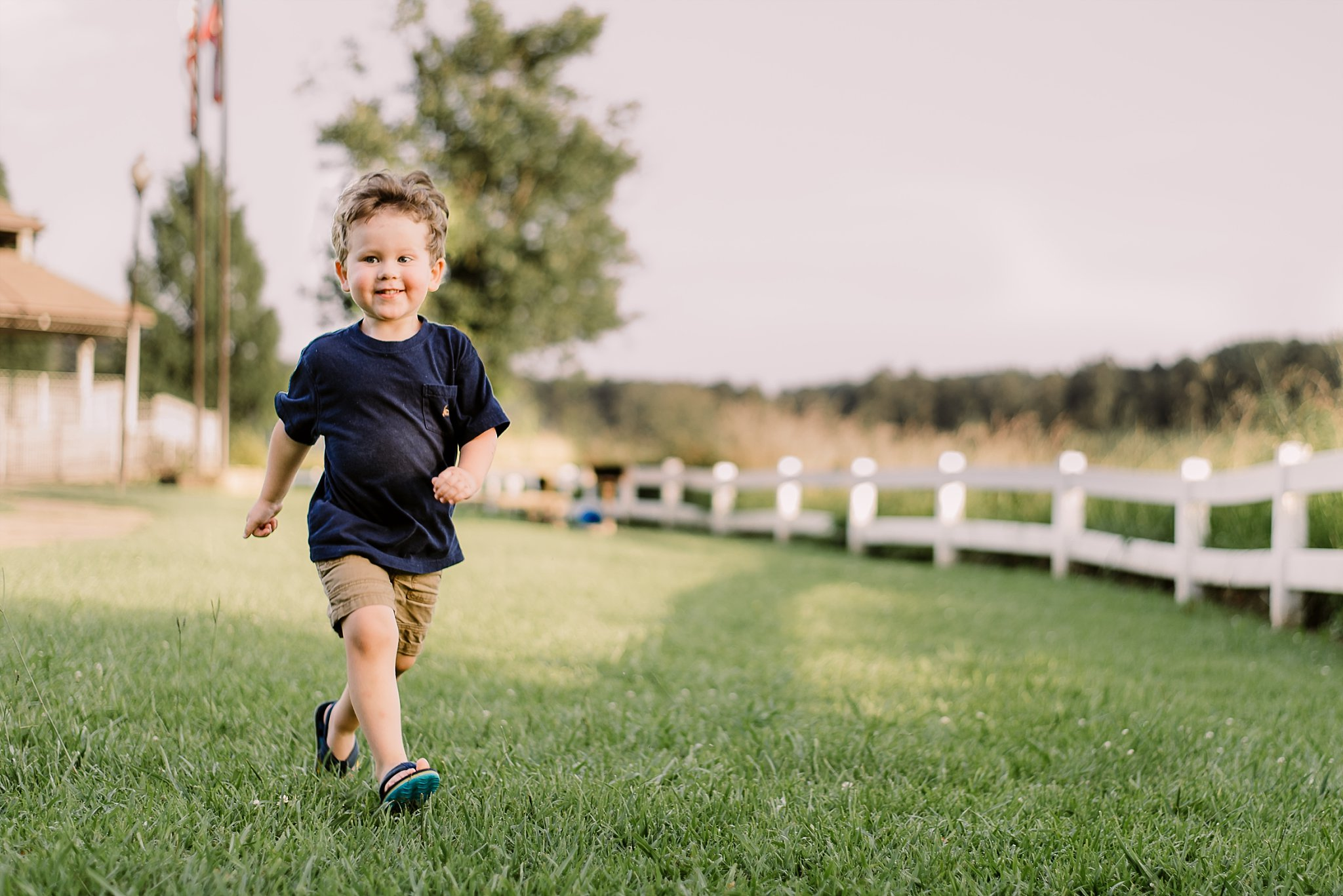 toddler boy running and laughing at Lake Acworth Cauble Park