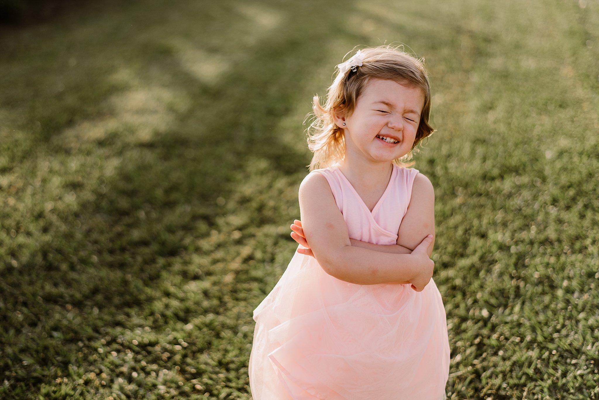 toddler girl in pink dress laughing Cauble Park Lake Acworth