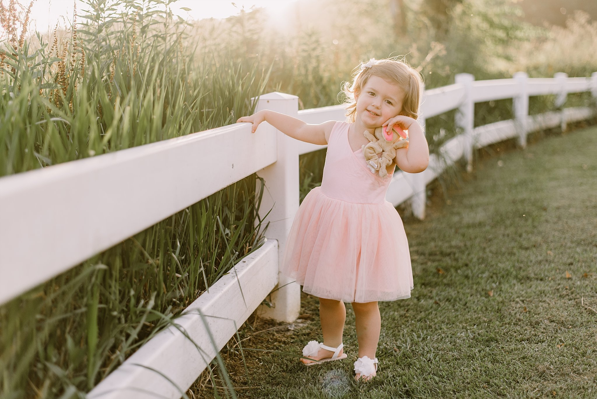 toddler girl in pink dress by white fence Cauble Park Lake Acworth