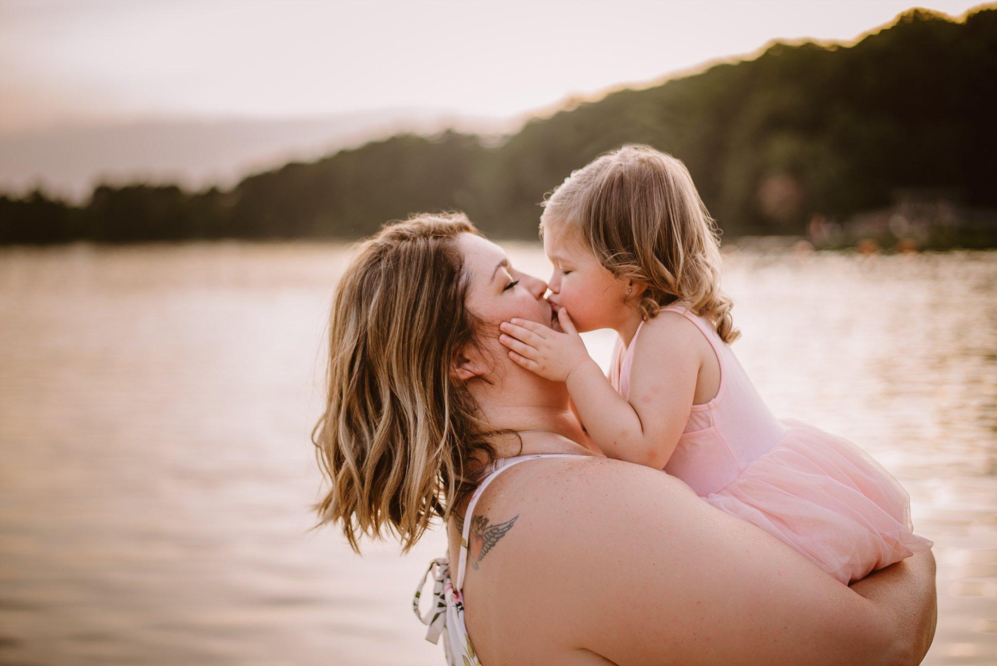 toddler girl kissing mom at beach Cauble Park Lake Acworth
