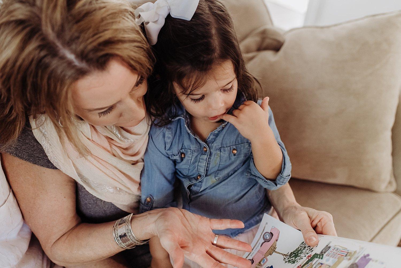 grandma reading to grandaughter