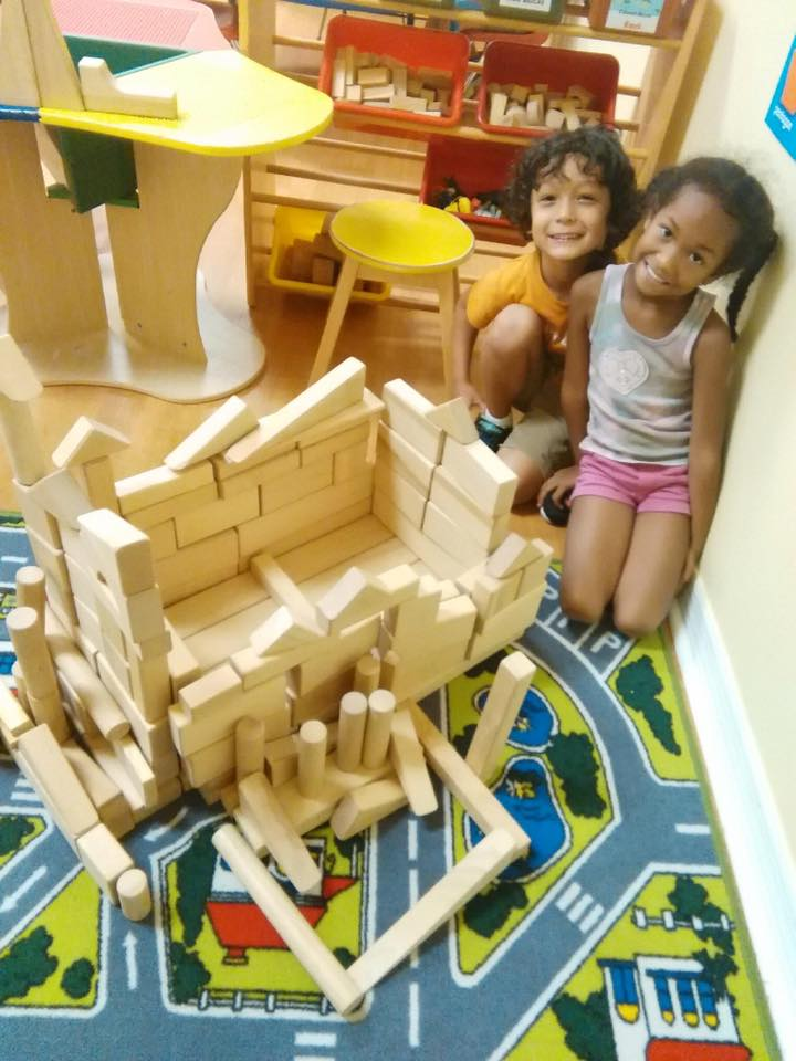 "Two proud Lake Mary Childcare children playing with blocks, constructing a ""tennis court"". (It really doesn't matter what you think it is)   Photographs by kind courtesy of their parents"